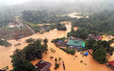 At least 24 killed in Malaysia, Thailand floods as 200,000